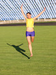 Beautiful teenage sport girl running on the grass.