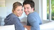 Closeup of cheerful young couple sitting in couch