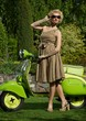 Woman in retro dress with a scooter
