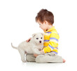 kid hugging puppy on white background