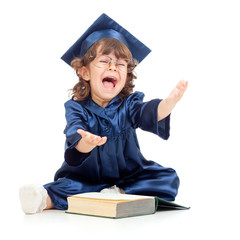 Emotional funny child in academician clothes  with book