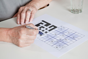 Mature Woman playing Sudoku Puzzle