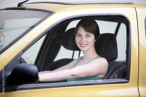 Happy woman in her new car