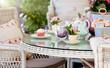 Leinwandbild Motiv Afternoon tea and cakes in the garden