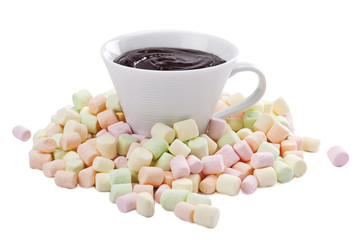 pile of colorful marshmallow and cup of melted chocolate