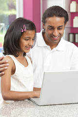 Asian Indian Father & Daughter Using Laptop Computer at Home