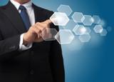 business man push a hexagonal touch screen button