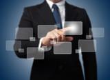 Businessman touching high tech type of modern buttons on a virtu