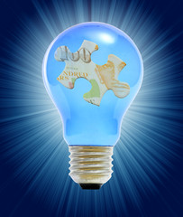 puzzle in lightbulb as a concept of business