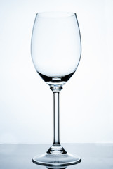 Empty wine glass on a white background.