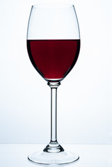 Glass of red wine on a white background.