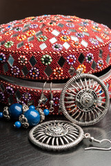 Old indian jewelery box with the earrings.