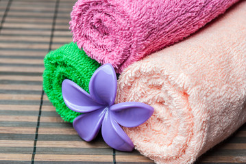 Spa towels rolls and flower.