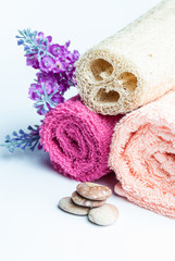 Spa towels rolls, flower and stones.