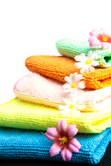 Stack of towels and flowers.
