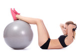 Beautiful woman doing abs exercises with fitness ball