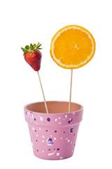 strawberry and slice orange on stick