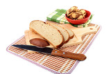 Slices of bread with  knife chopping board and  towel on a white