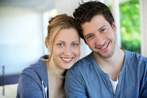 Closeup of cheerful young couple wearing blue