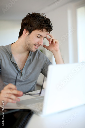 Young man studying from home