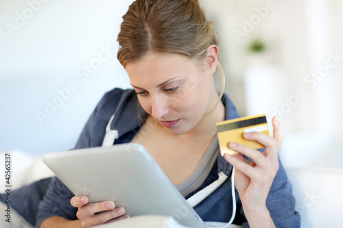 Closeup of beautiful blond girl doing online shopping