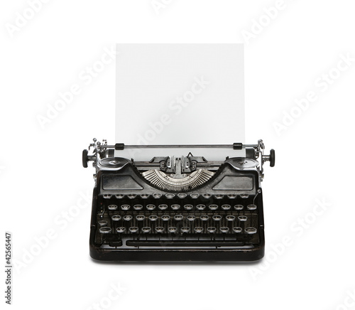 Retro rusty typewriter isolated on white background