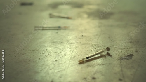 Syringes used for heroin and drugs on dirty floor