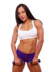 Portrait of muscle woman posing in studio