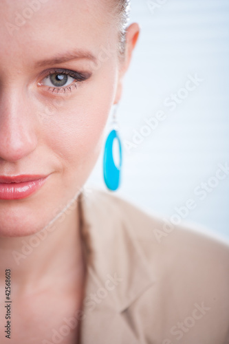 Closeup portrait of a beautiful young positive smiling woman iso