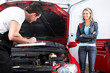 Professional auto mechanic and  a client.