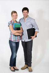 Cheerful students holding files