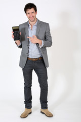 Attractive man pointing at calculator