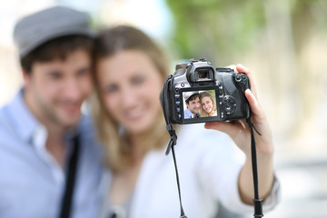 Young couple taking picture of each other