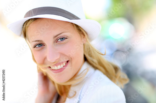 Closeup of beautiful young woman with hat