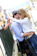 Young in love couple kissing each other in town