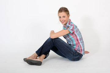 Young beautiful student girl sitting with legs crossed