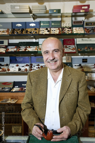 Portrait of a mature tobacco shop owner