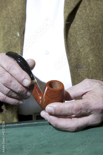 Close-up view of owner holding tobacco pipe