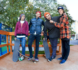 Four friend in skatepark