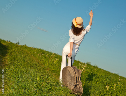 Young woman hitchhiking
