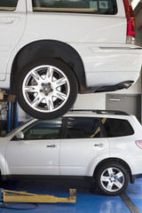 Car on hoist in automobile repair shop