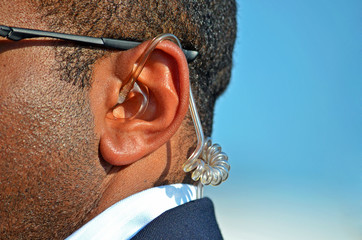 earpiece in secret service man's ear