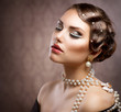 Retro Styled Makeup With Pearls. Beautiful Young Woman Portrait