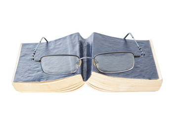 Glasses on the book, closeup.