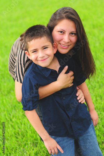 Beautiful mom hugging son