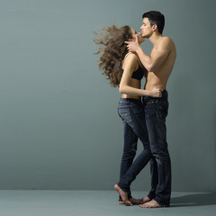 Sexy young couple wearing jeans in love