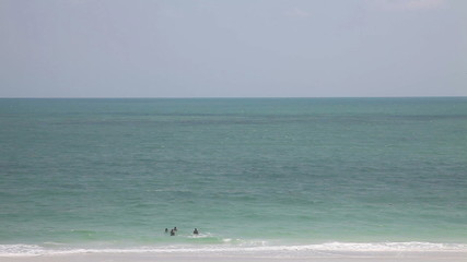 Lido beach, Florida. people swim in a clear day