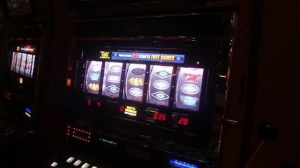Someone playing slot machine in vegas