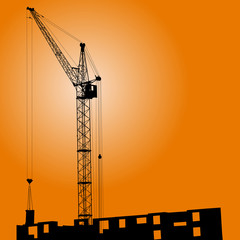 Silhouette of crane on a sunset on a building
