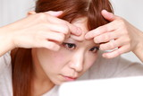 woman  worries about a pimple poster